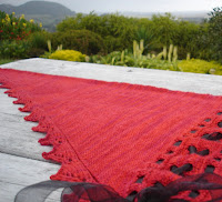Isabelle by Gabriella Henry. Sideways knit shawl with ribboning detail. Pretty or steampunk, you decide.