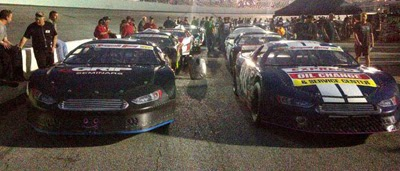 The cars sit on pit road waiting for qualifying for the Snowball Derby at Five Flags Speedway in Pensacola, Fla., on Friday, Dec. 6, 2013.