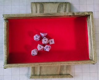 One set of standard dice in the tray