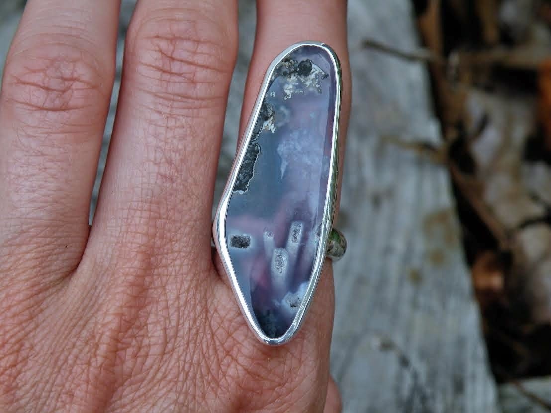 http://www.meshedesigns.com/collections/one-of-a-kind-rings/products/purple-chalcedony-ring-size-7-25