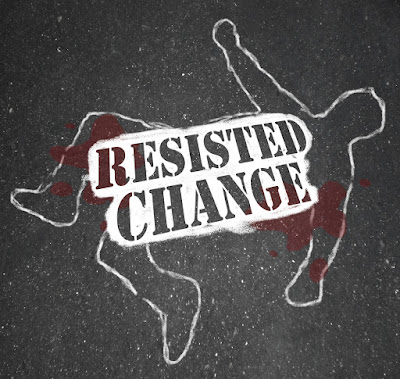 "A chalk outline of a victim on the street with a sign saying, ""Resisted Change"""