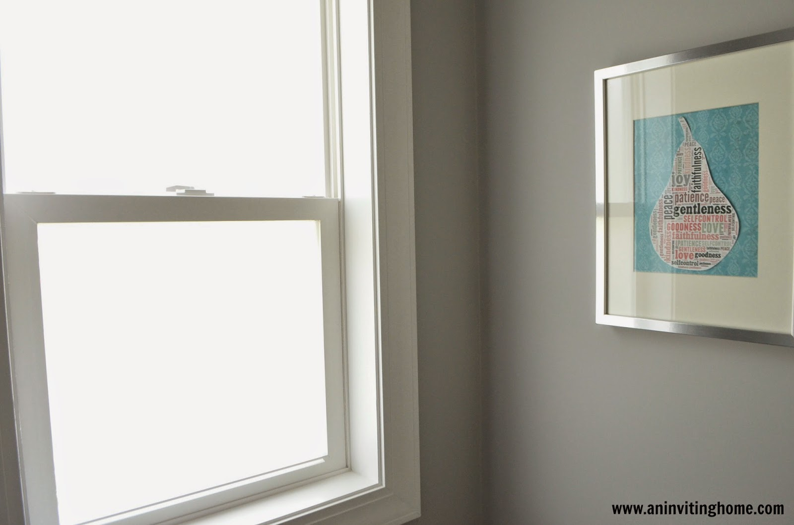 installing privacy film in the bathroom window