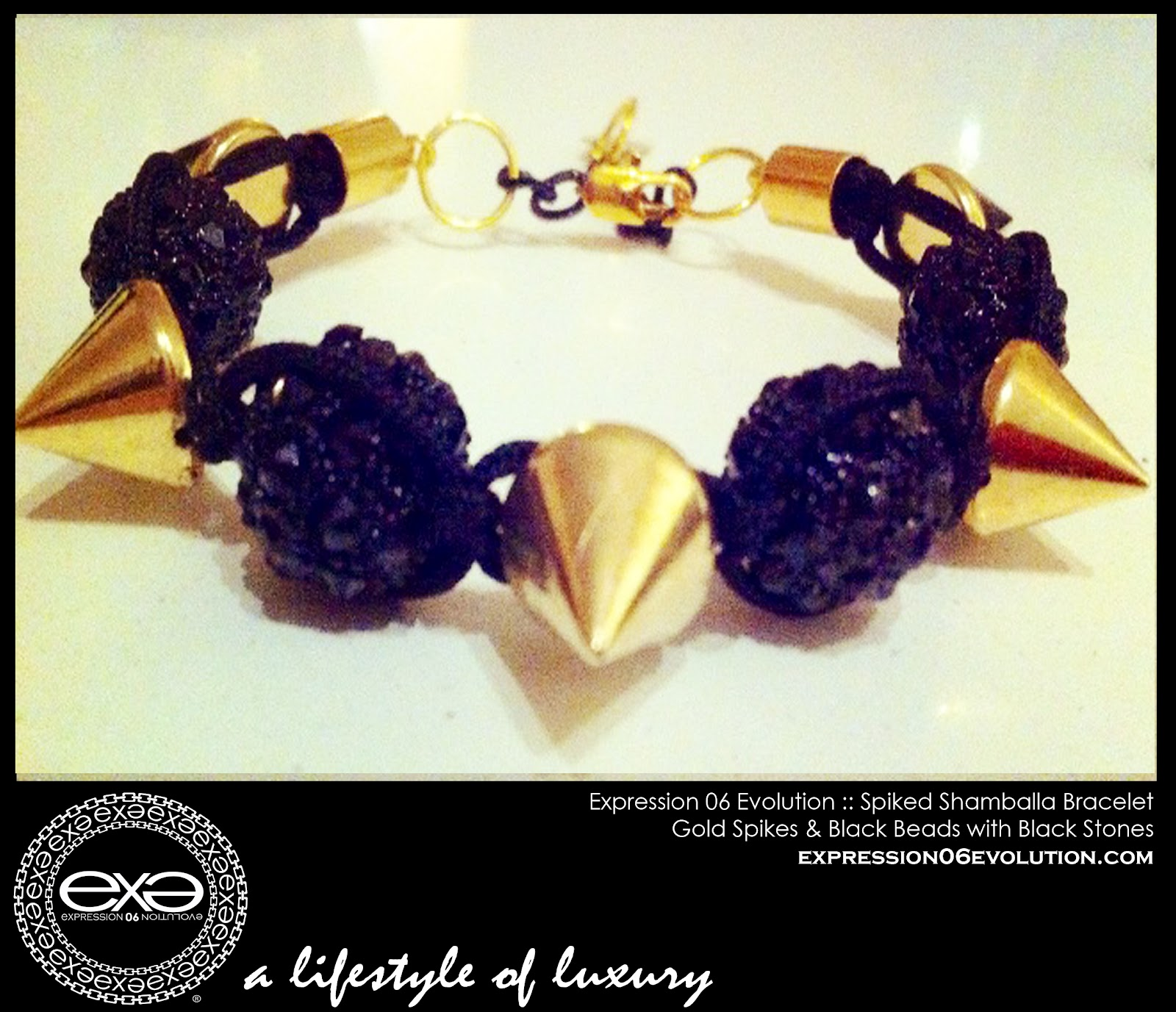 http://2.bp.blogspot.com/-pgPv9O-3SNM/UCY3r6YG-AI/AAAAAAAAB2c/NMwiOe7wR8w/s1600/EXPRESSION+06+EVOLUTION+-+SPIKED+SHAMBALLA+BRACLET+-+GOLD+SPIKES+WITH+BLACK+STONES+-+EXPRESSIVE+CLOTHING+LLC+-+DUSHON+EX+DANIELS+-+ALEXIS+BELSKI+.jpg