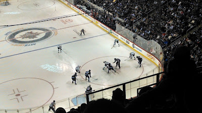 The two teams faceoff in the Jets' end as they kill a penalty