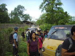 "Trekkers queuing in a file  at Thakurwadi village and heading towards ""Prabalmachi village."