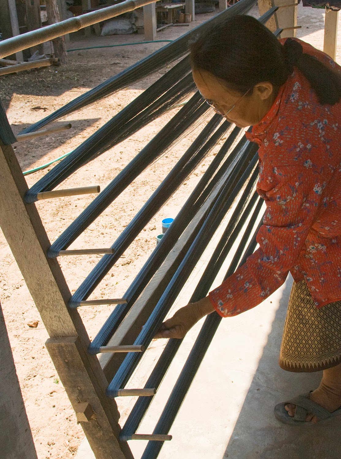 This Thai weaver uses a warping board to measure 40 metres of organic silk yarn to keep it free from tangles.