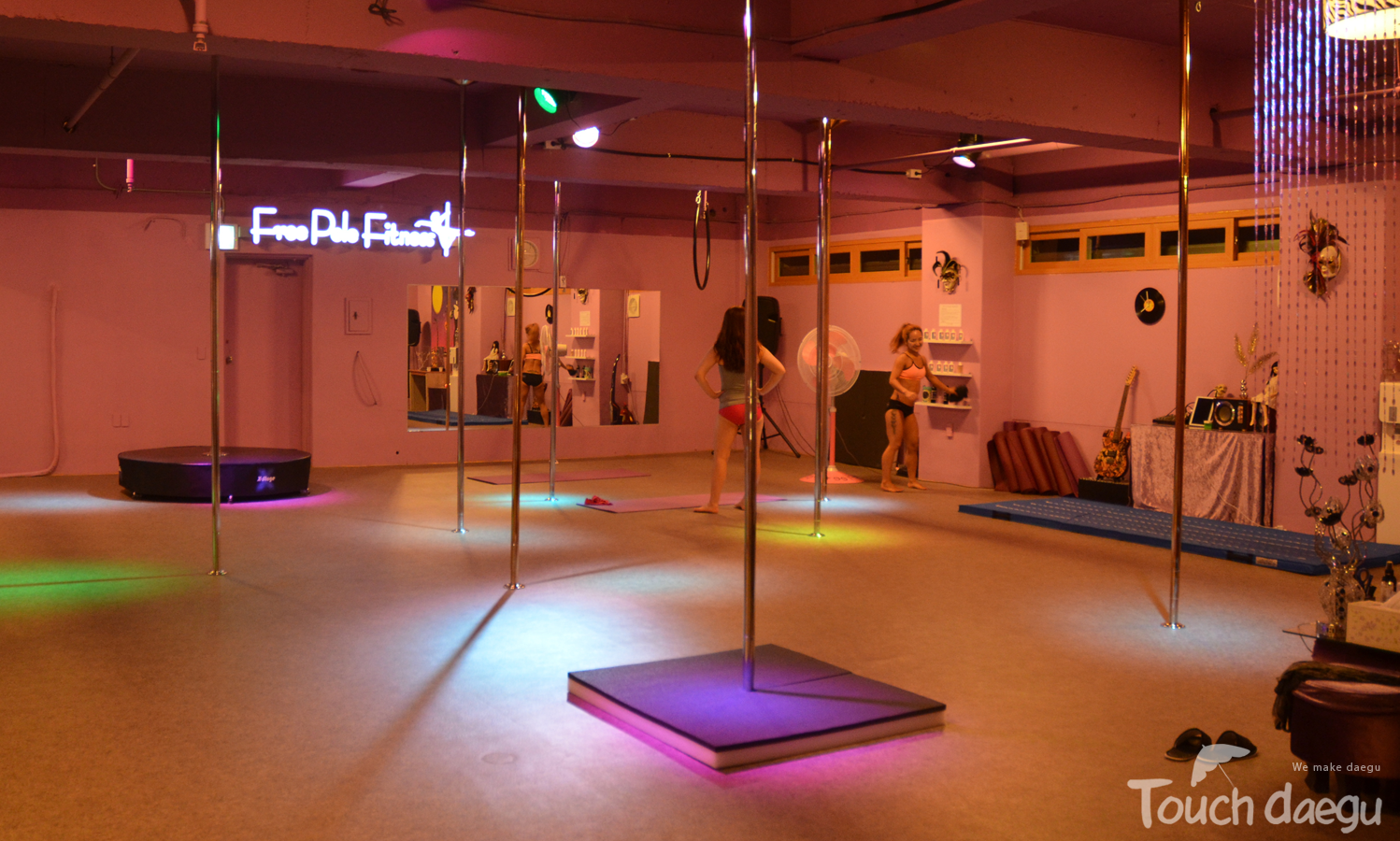 People practice pole dancing at free pole fitness