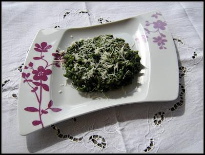 risotto alla crema di spinaci e salsiccia mantecato al provolone