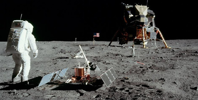 Apollo 11 crew member Buzz Aldrin is setting up the retroreflector and seismometer experiments on the moon. Credit: NASA