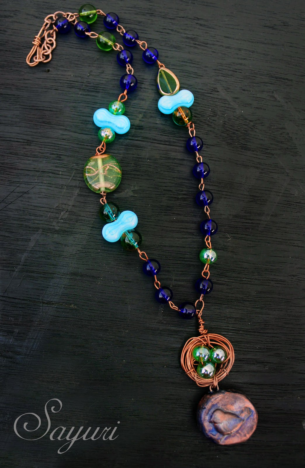 Emerald and Sapphire Bird's nest necklace