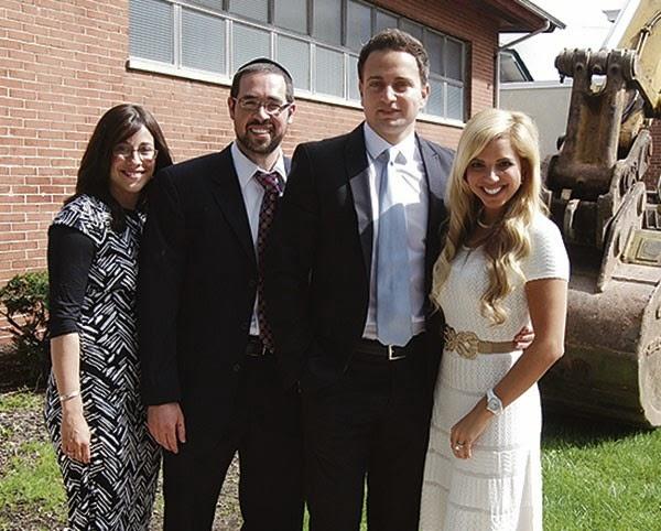 Rabbi Joshua Hess and his wife Naava, left, join benefactors Mark and Kim Roshanski at the mikva ground-breaking ceremony.