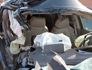 Photo of the aftermath of a bad accident, including child safety seat.