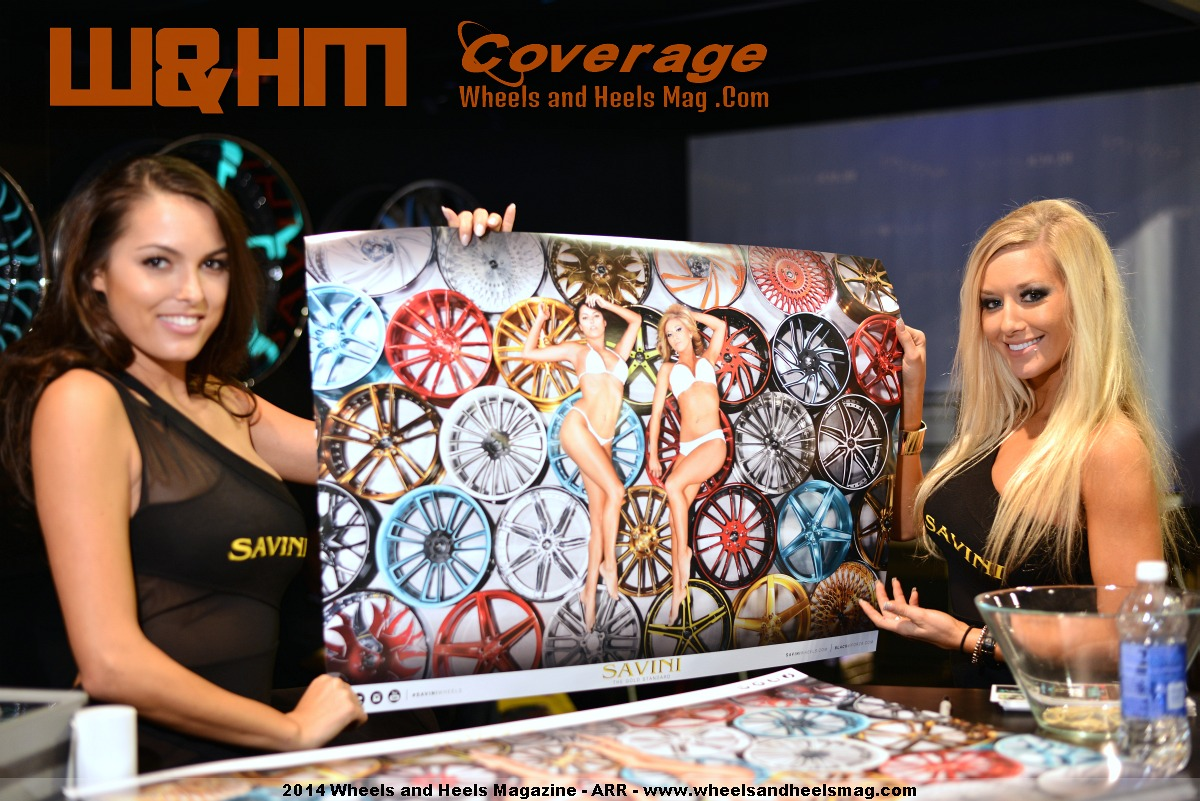 Constance Nunes and Elise for Savini Wheels at 2014 SEMA Show with their official poster by Wheels and Heels Magazine / Py25 Studio