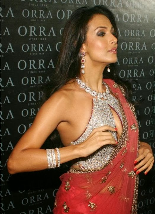 Malaika Arora Khan In Pink Transparent Saree Adjusting her blouse covering her big round cleavage pics