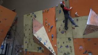 Boy Bouldering in Climbing Gym