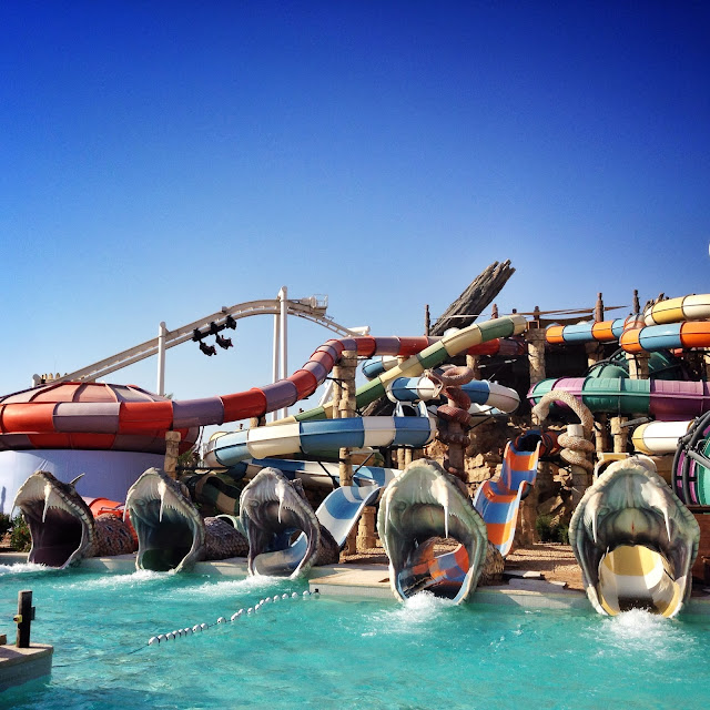 Slither Slides and rollercoaster at Yas Waterworld