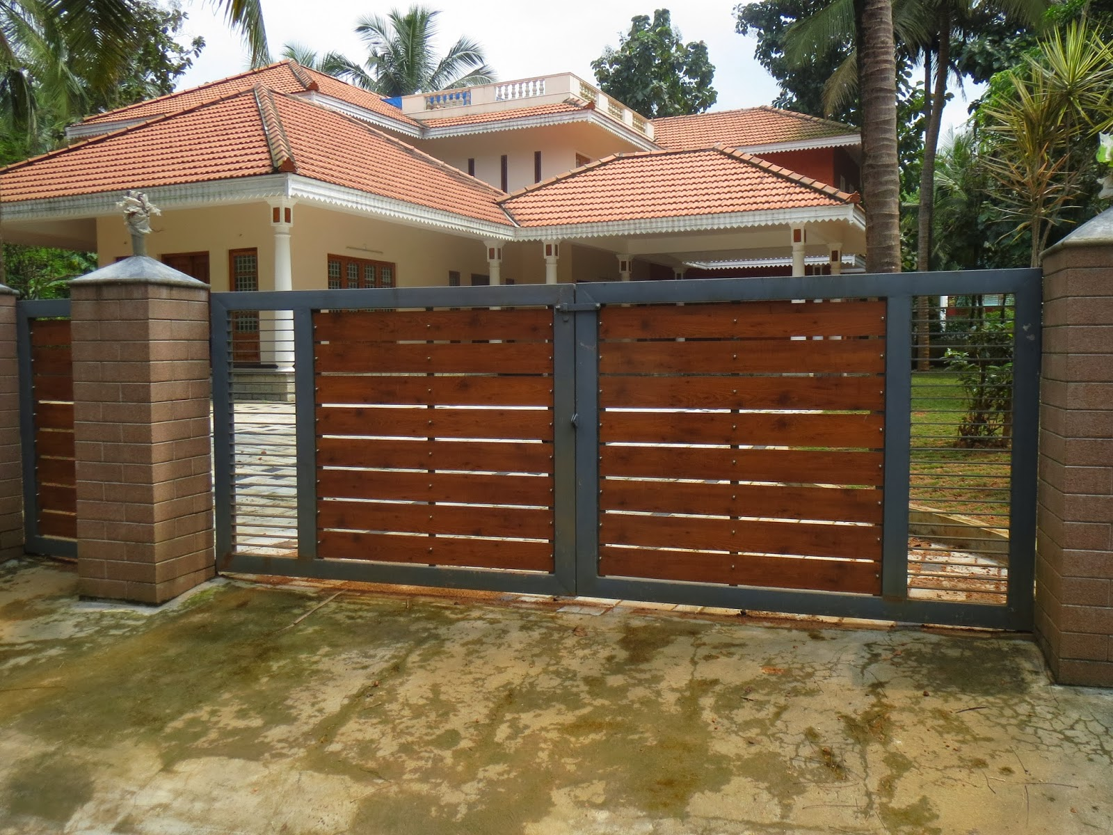 Kerala gate designs house gates in kerala india for Home gate architecture