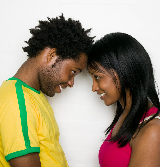 Young couple intimately looking into each other's eyes.