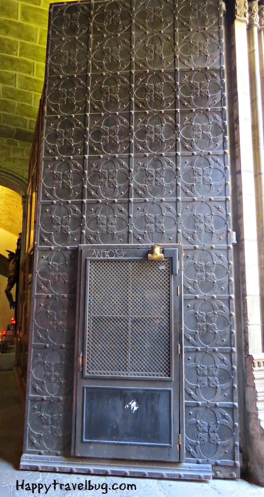 Church door within a door in Barcelona, Spain