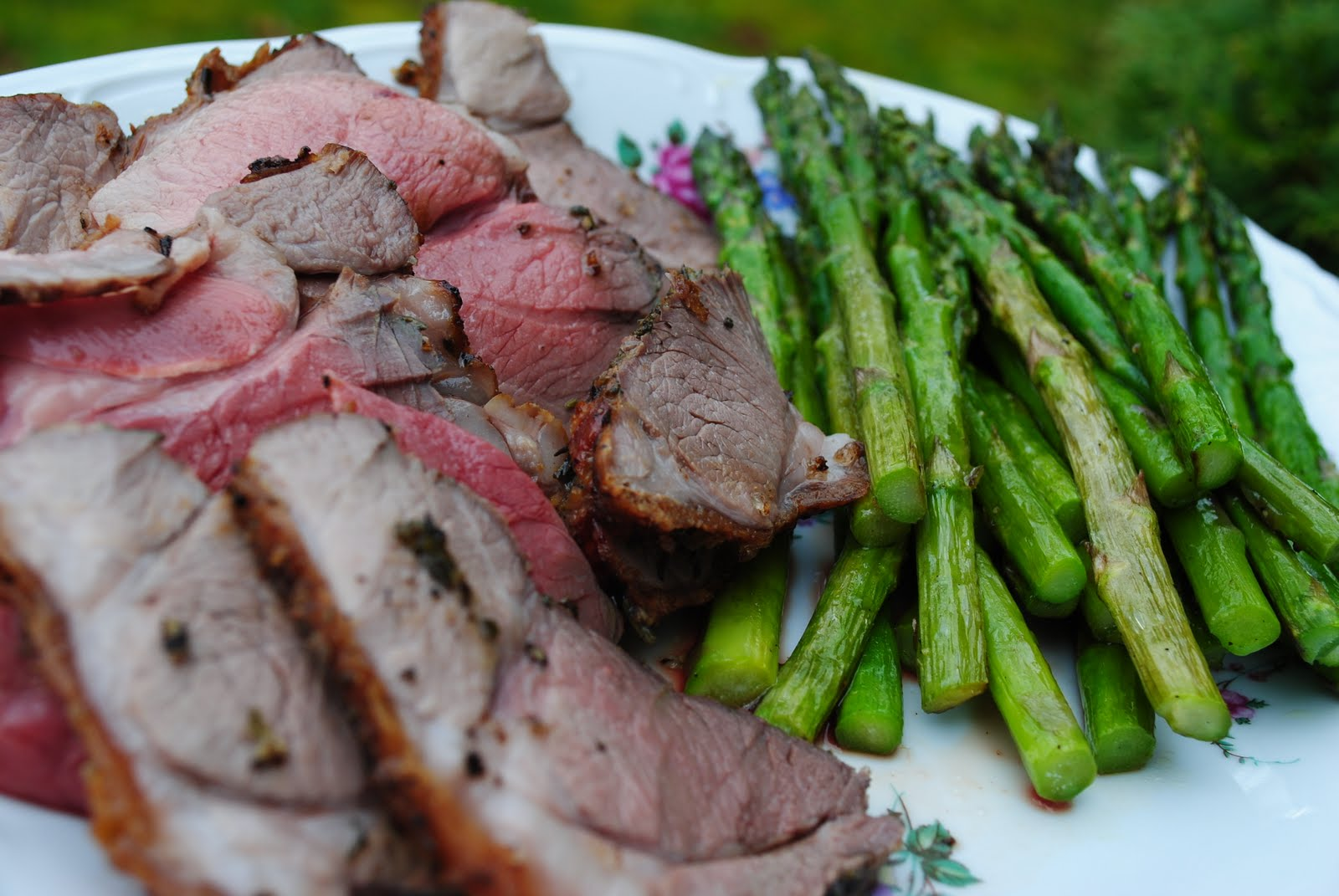 left: roasted leg of lamb with fresh herb crust and roasted asparagus