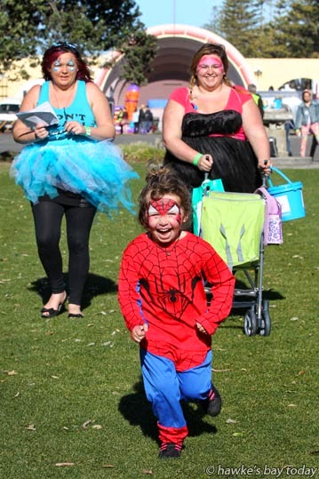 L-R: Sam Hawke, Napier, Lily Wilson, Amber Wilson, Napier, near the Sound Shell, Napier, taking part in a Locals Day i-Spy Fun Challenge, run by Napier i-SITE. photograph