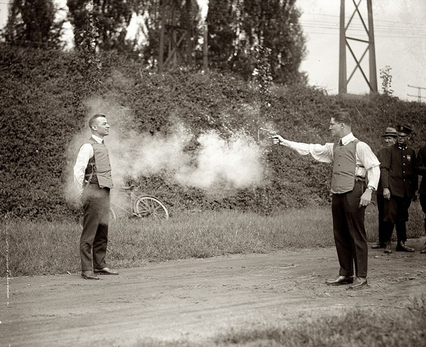 W.H. Murphy and his associate demonstrating their bulletproof vest on October 13, 1923