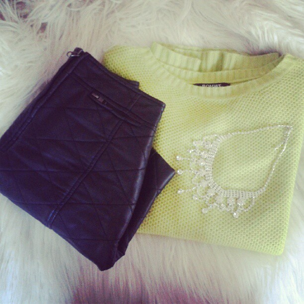 fashion set with neon sweater, quilted skirt and crystal necklace