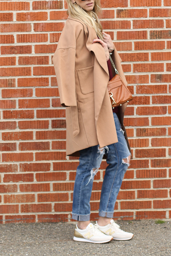 draped tan coat