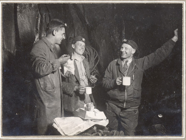 Lost Johns' Cave, Leck Fell. Leeds Cave Club meet Easter 1932. A meal at 3am, 3rd April in Candle Pot, nearly 400 feet from the surface. (Cliff Wilkinson, Flemming and Brench).