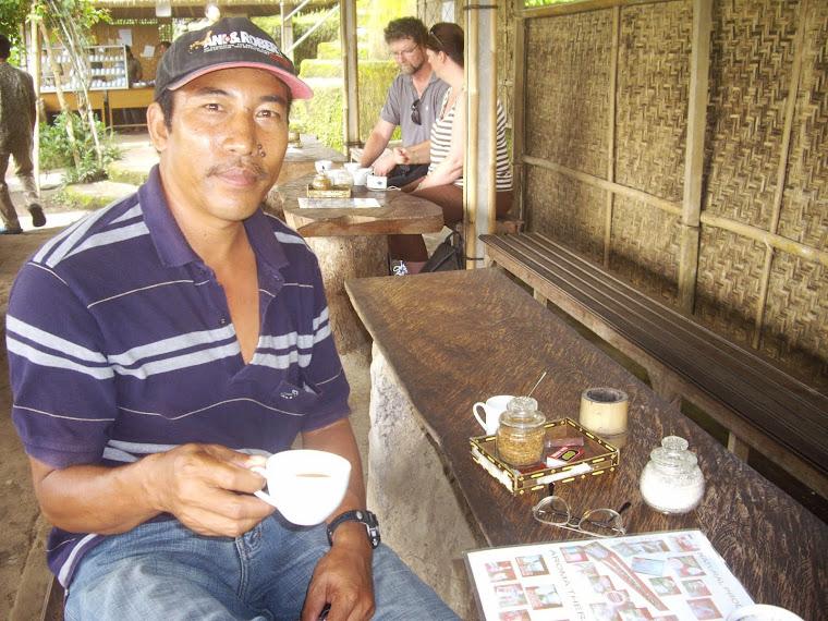 WAYAN SARMA DRINKING CUP OF RARE KOPI LUWAK (CIVET COFFEE), BAS AGRO, BALI