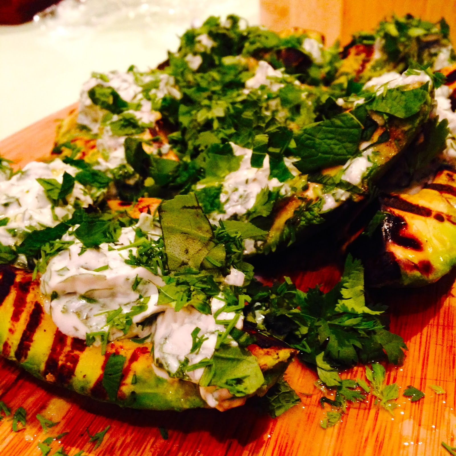 Chargrilled avocado salad with coconut yoghurt and fresh herbs