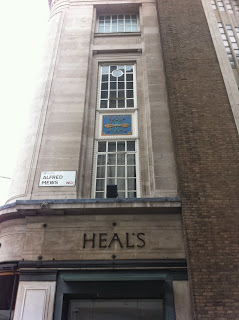 Old signs on the side of Heal's separtment store, Alfred Mews, London