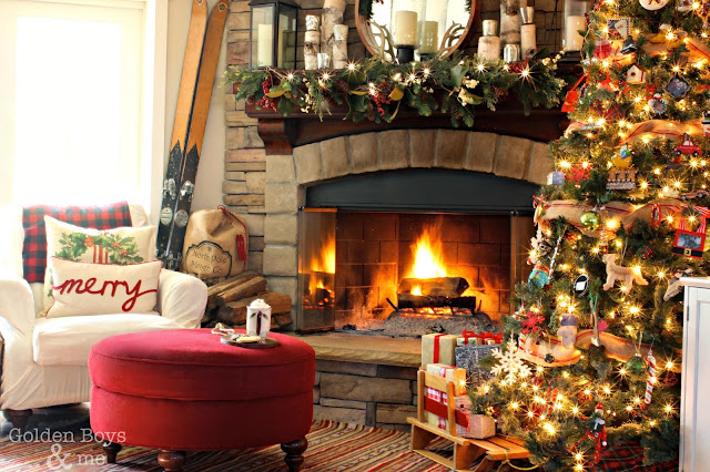Rustic lodge style corner stone fireplace at Christmas with sure fit slipcover on chair-www.goldenboysanmde.com
