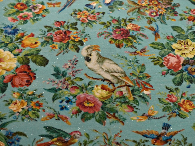 White parrot, dragonfly and bunches of flowers on the detail of Peranakan beaded tablecloth