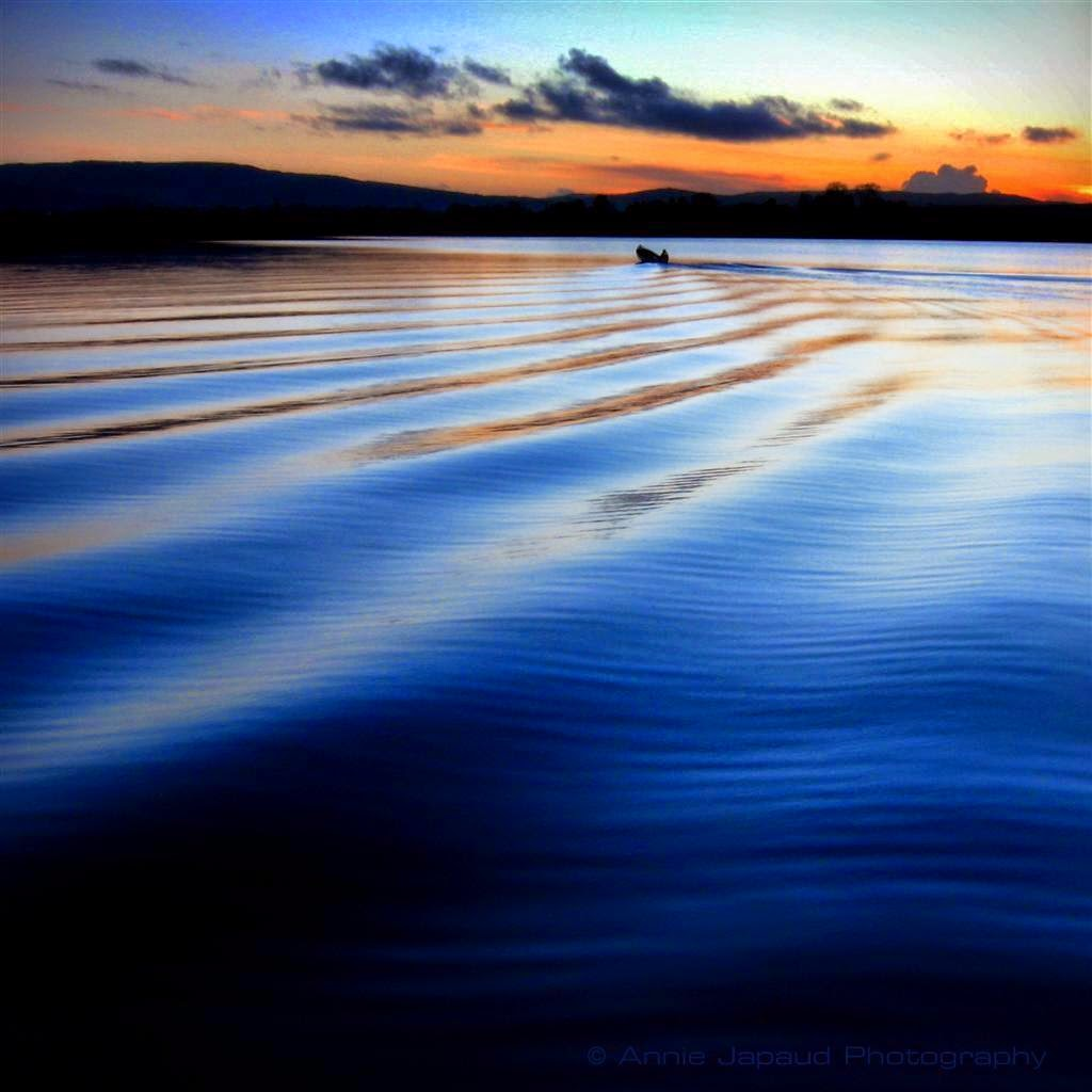 sunset, Oughterard pier, boat, fishing, ripples in the water, coloured sky, clouds