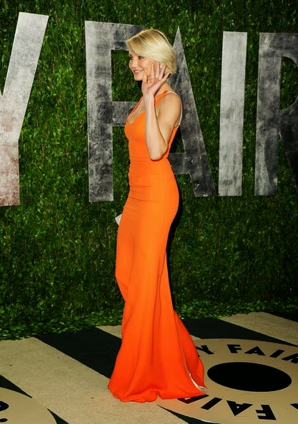 `Bad Teacher` star Cameron Diaz looked remarkably stunning in a sleek vibrant orange gown from the Spring 2012 collection by Victoria Beckham at the 2012 Vanity Fair Oscar Party hosted by Graydon Carter at Sunset Tower on February 26, 2012 in West Hollywood, California. The beautiful actress paired her bold tangerine-coloured dress with grey mist shoes, David Webb jewels, including a pair of oversized diamond chandelier earrings and a thick bangle.