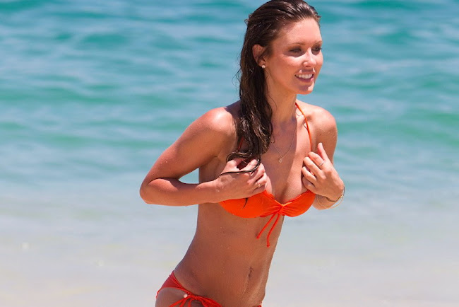 AUDRINA PATRIDGE on a beach in a orange bikini