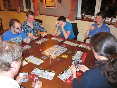 RoboRally - The players planning their moves with much concentration and some already showing signs of stress!