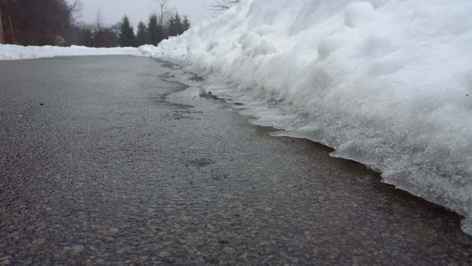 the separation of snow and ice from the road surface