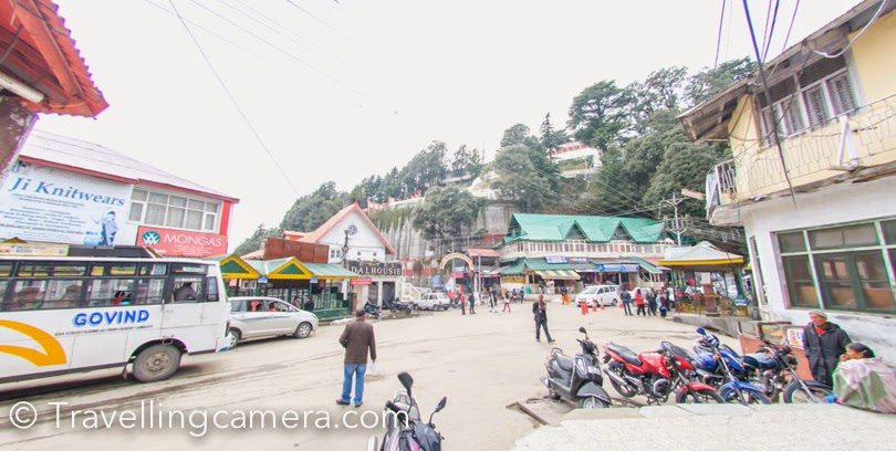Recently I was in Dalhousie to visit my niece and during one of the days we planned to walk around the mall road in Dalhousie town This Photo Journey shares about some of the interesting places on mall road and few tips for folks planning to visit Dalhousie.Gandhi Chowk is probably the most happening place in Dalhousie town. Dalhousie town is comparatively a smaller town as compared to other popular hill stations and that's why it's a peaceful place. Although don't expect this peaceful enviornment during summers :), which lot of folks from Punjab come here with their kids to spend vacations. Gandhi Chowk is a good place for shopping in Dalhousie. Check out Apple products and some fruit wines produced in Himachal. We also bough few packs of apple pickle, which is yet to be tasted :)These beautiful snow covered mountains of Pir Panjal can be seen from Gandhi Chowk. First two photographs are clicked at Gandhi Chowk. The popular St John's church is situated on Gandhi Chowk and the very first photograph in this Photo Journey shows the same.Mall road connects Gandhi Chowk with Subhash chowk on other side of the town. This whole road overlooks at the beautiful Pir Panjal mountain ranges covered with snow. These hills had got fresh snowfall few days back and they were looking awesome. In above photograph, the bottom part shows cantt area of Dalhousie which is next to Banikhet.  The clouds around these snow capped hills were continuously changing the hues and every shade was looking brilliant.  Throughout the mall road, various seating arrangement are done. All these places are quite cleaner. These places are so beautifully designed that you feel like taking a pause and sit there to enjoy the brilliant of nature around Dalhousie. Above is one of the views from Mall road. This is Ravi river which keeps changing her views during the day. Many times, it's not even visible because of dense clouds all around Dalhousie town. During 3 days stay, we saw Ravi 2 times for short span of time.Mall road in Dalhousie has some of the exceptional private properties, which are quite expensive as well. Above is not a house but a school near church. I intentionally avoided clicking any personal property there.Clouds keep playing around the town and within minutes you see very contrasting enviornment. Completely hazy view at one moment and bright/clear view after a few minutes. Imagine clouds passing by you and indicating that be ready for showers in a while, so plan accordingly :).After walking through the Mall road we finally hit Subhash Chowk which exposes you to the green valley on the opposite side of snow covered Pir Panjal mountain ranges. St. Francis church is located on Subhash chowk, which is much bigger than the one on Gandhi Chowk. There is a small space in this campus, which is dedicated to colorful birds, rabits, ducks. We had a quick round of this church and got down to the Mall road for tea. Urvi, my niece, was sleeping by that time and we wanted to head back now. We called our taxi guy and headed to the home which is 4 kilometers from Dalhousie town.Apart from the Mall road, there is another smaller and beautiful pathway which connected Subhash Chowk with Gandhi Chowk. This is supposedly the preferred route for local folks who want to same time and energy :), but tourists love the Mall road walk because it exposes you to brilliant views of Himalayas.  The whole Mall road is surrounded by Deodar trees which add more to the beauty of this town. Dalhousie has been one of my favorite towns and I like the fact that it's not becoming concrete jungle like other hills stations (Shimla, Mussourie etc.)Do drop us a comment, if you want know more about the place or have some specific queries.