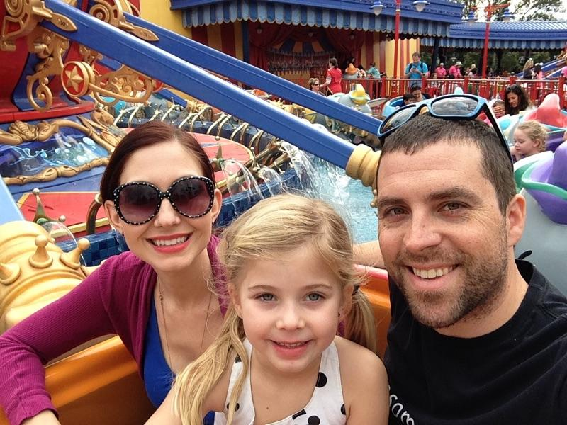 Amy West and family on a ride at the Magic Kingdom