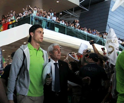 Cristiano Ronaldo returns to Portugal after Euro 2012