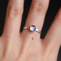 Simple amethyst and silver ring modelled on a hand