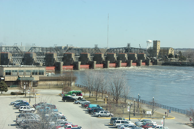 Photograph from a fourth story walkway of the Mississippi River and the water control system.