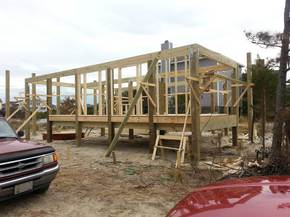 Modular home builder building a home on pilings for Wood piling foundation cost