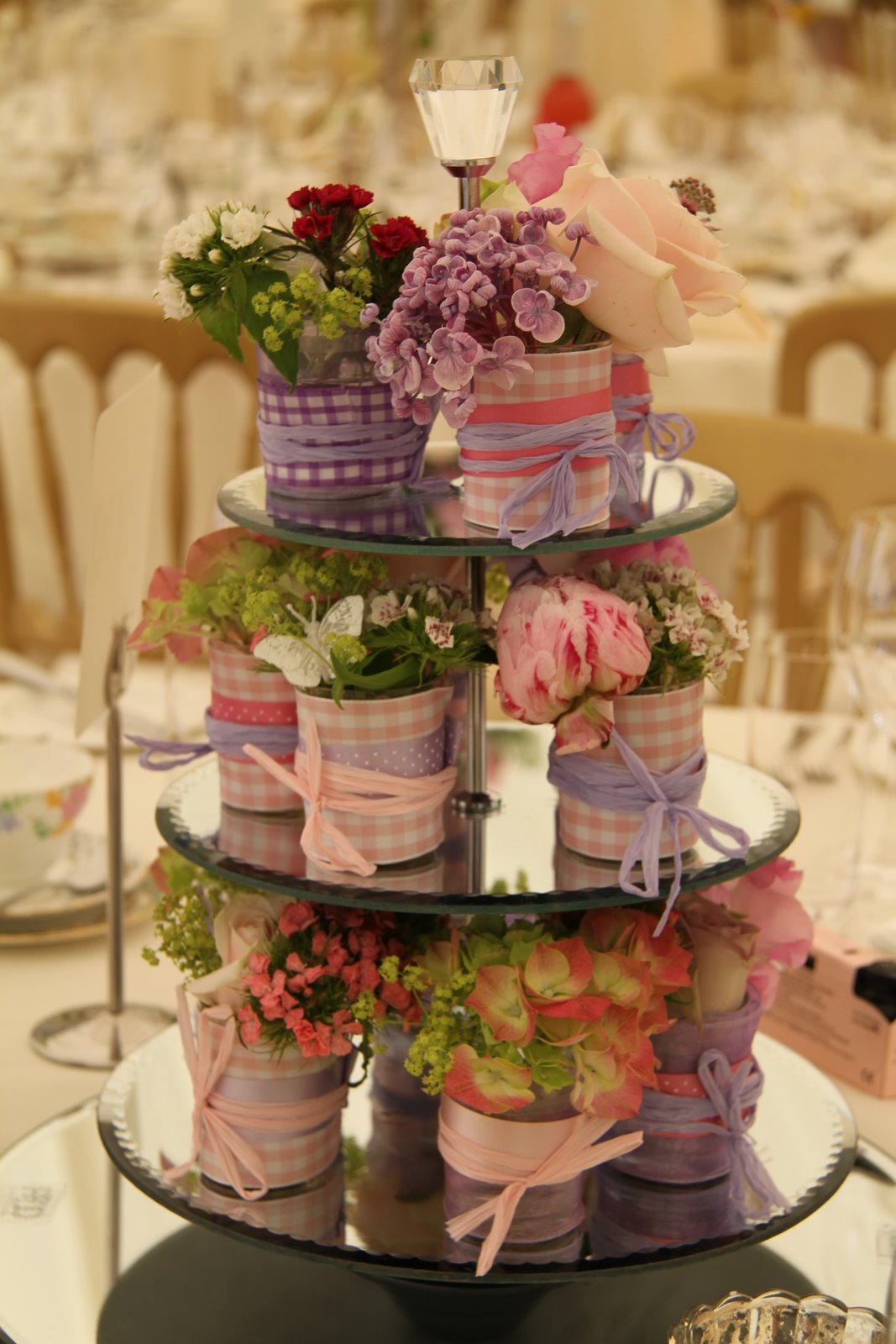 Flower design table centrepieces three tier cake stand
