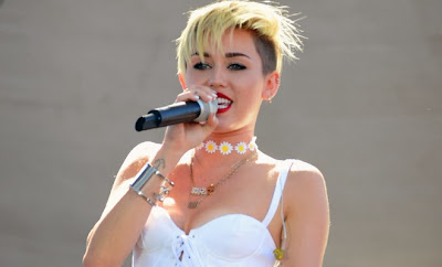 Miley Cyrus instructed the phase on draw humourous 'Staurday Nights Live' serving while equally host and music invitee.
