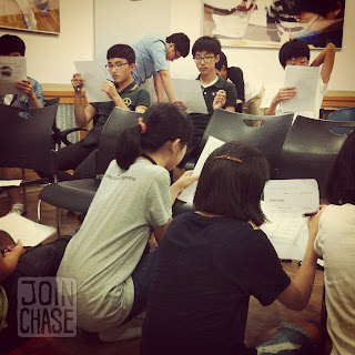 Middle school students work on a class project in South Korea.