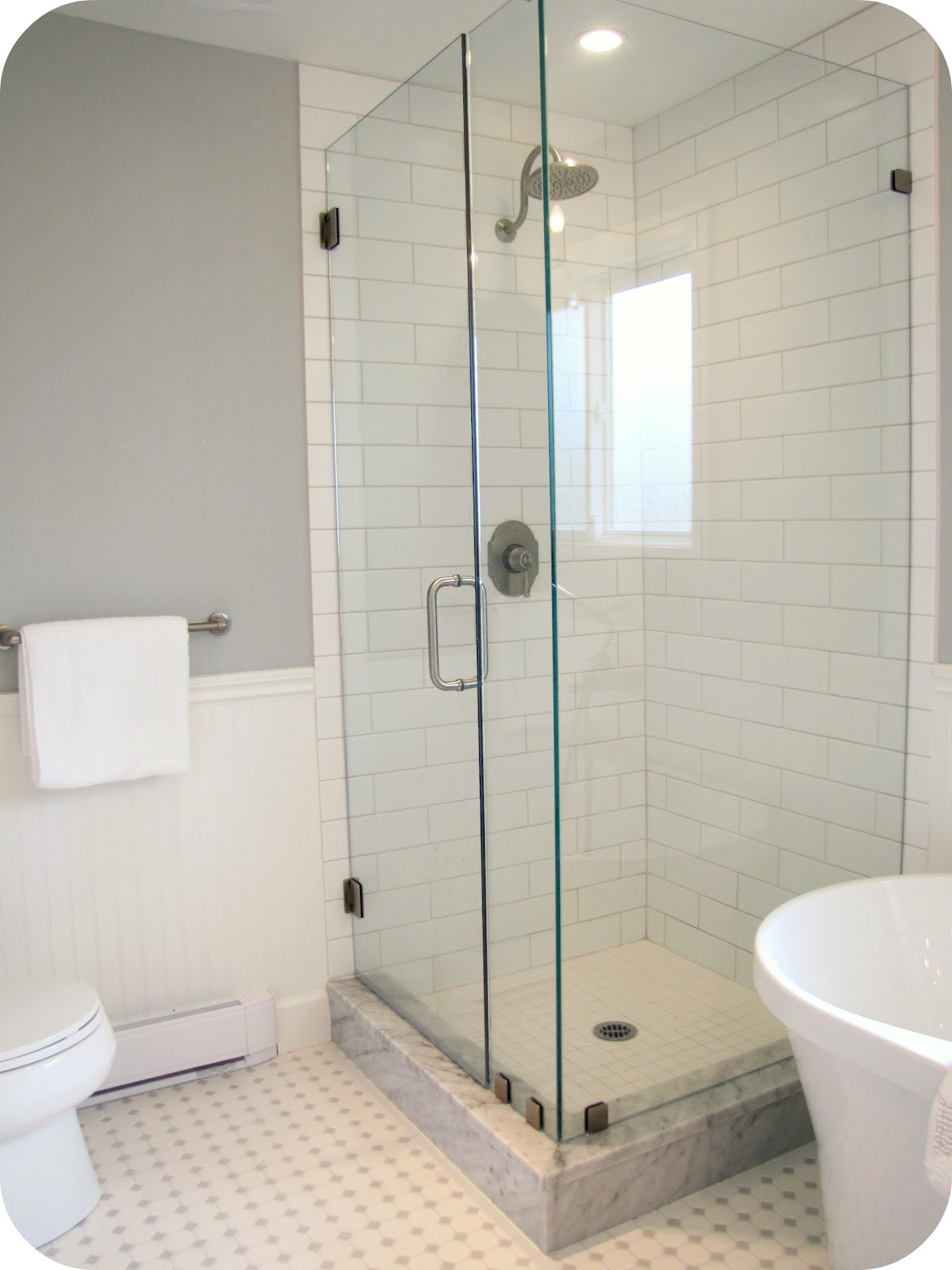 Bathroom idea shower tile bathroom shower bathroom 2 bp blogspot com - Glass Shower Walls White And Grey Bathroom Renovation Makeover Carrera Marble Hex Tile Image Source 2 Bp Blogspot Com