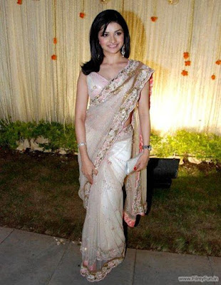 Prachi Desai looks adorable and very feminine in her embellished gossamer sari